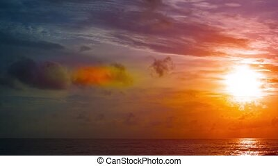 Sun Slowly Setting over a Dramatic Tropical Seascape -...