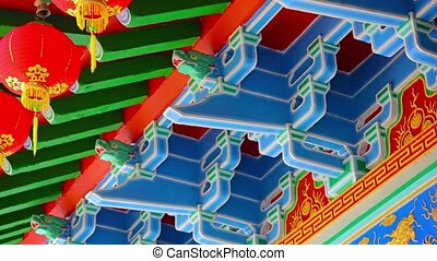 Intricate Ornamentation inside a Chinese Buddhist Temple -...