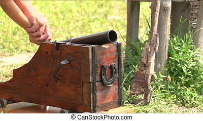 man shoots from a small cannon
