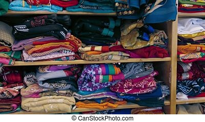Indian Style Clothes, Folded on Shelves in a Shop - video...