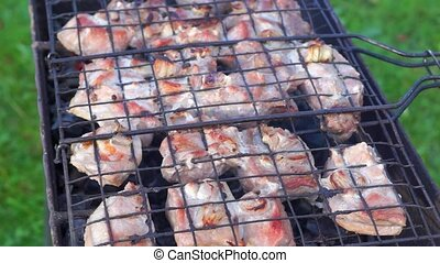 Cooking barbeque on coal heat of br - Meat pieces on skewer...