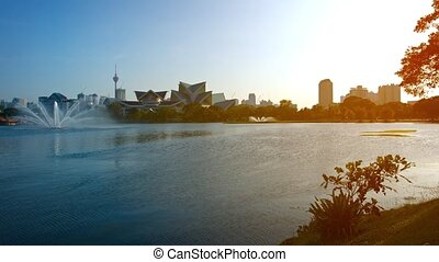 Sunset over an urban lake in Kuala Lumpur - Video 1080p -...