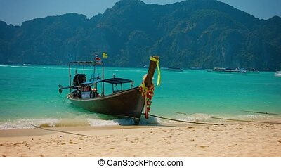Beautifully Decorated Longtail Boat on a Tropical Beach in...