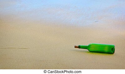 Green Glass Wine Bottle Rolling in the Surf, with Sound -...
