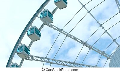 Giant Ferris Wheel Turns Slowly against a Cloudy Sky - Video...