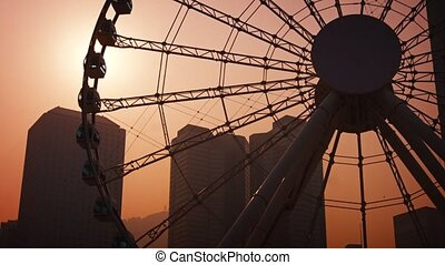 Enormous Ferris Wheel Turns in the Hazy, Late Afternoon...