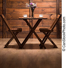Romantic atmosphere in wooden cafe - Wooden table and two...