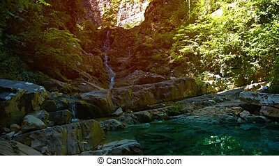 Narrow Natural Waterfall Meandering down Rocky Course -...