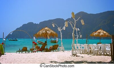 Tourists Resting in the Shade on Phi-Phi Island in Thailand...