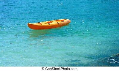 Orange, Plastic Kayak, Anchored in the Tropical Sea