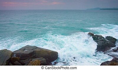 Gentle Waves of a Tropical Sea washing over Boulders - video...