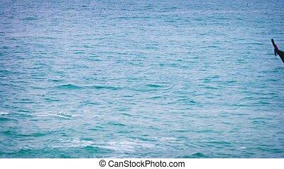 Boatmen Pilot their Fishing Boat through a Calm, Tropical...