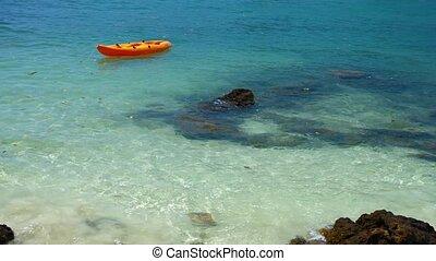 Anchored Orange Kayak near a Rocky Tropical Beach - Video...