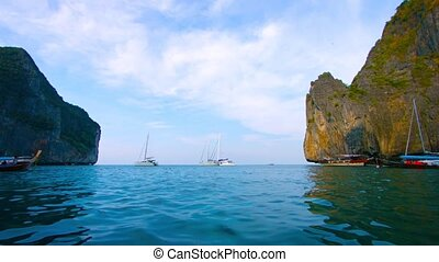 Sailboats at Anchor under Seacliffs in Southern Thailand -...