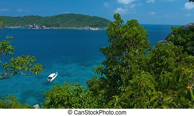 Tour Boat at Anchor in a Crystal Clear Tropical Bay - Video...
