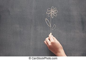 Drawing flower - Woman drawing a flower on a blackboard