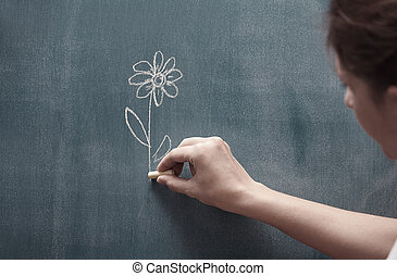 Drawing flower - Human hand holding single flower drawn on a...