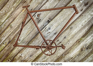 Rusted bicycle frame hanging on a wall