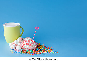 Many colored candy - Many colored sweets and mug on blue...