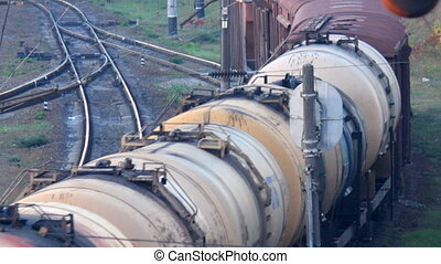 transportation of oil by rail - train with tank cars moving...
