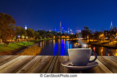 cup of coffee on the city background