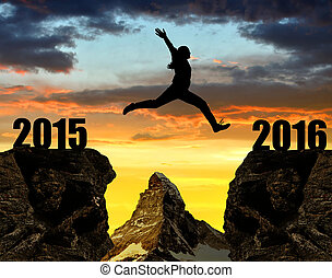 Girl jumps to the New Year 2016 at sunset.