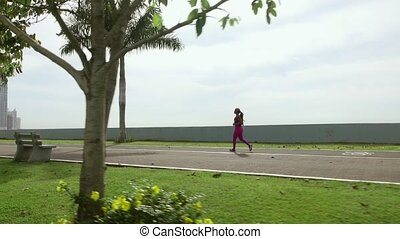 16 Woman Running And Working Out Outdoor At Morning - Young...