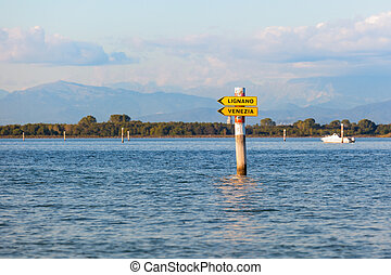 Boat sign in the lagoon of Grado Friuli Venezia Giulia,...