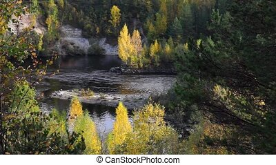Wild forest river in autumn - Suna river in wild taiga...