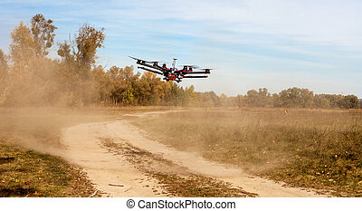 Octocopter, copter, drone - Copter flying at speed Copter...
