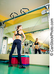warming up - Athletic young woman is training arm and...