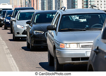 Traffic jam - Generic cars standing in a queue during...