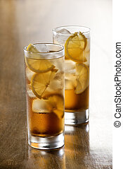 Ice tea - Glass of cold ice tea with lemon slices.