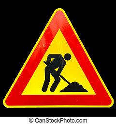 Road work sign isolated over a black background