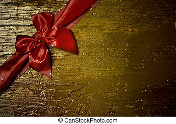 red bow greeting card - Old wooden background with beautiful...