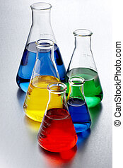Colorful chemicals - five flasks of colorful chemicals shot...