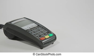 Hand swiping credit card on POS terminal - Hand swiping...