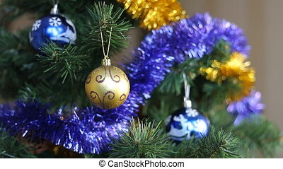 Christmas decoration blue and yellow balls on the tree