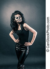 Halloween face art - Young woman in day of the dead mask...