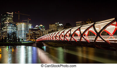 Calgary Peace Bridge Over the Bow River - Night view of...