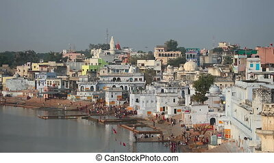 Pushkar lake - PUSHKAR, INDIA - NOVEMBER 20, 2012: people at...