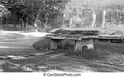 black and white, old stone bench in thel park