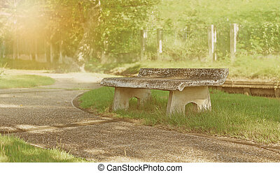 old stone bench in thel park