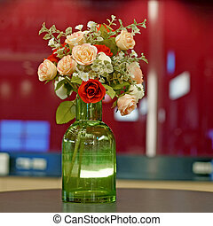 rose artificial flower in green vase - colorful of rose...