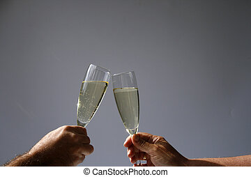 champagne toast - two hands with glasses champagne toasting