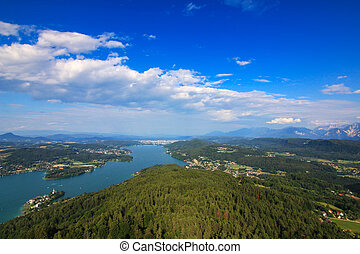 Alpine lake, Woerthersee in Austria - Landscape view of the...