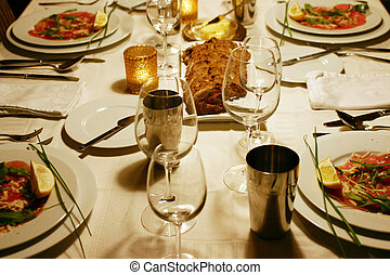 luxurious table setting with entree