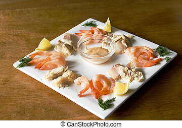 Fish platter - White plate with fish snacks