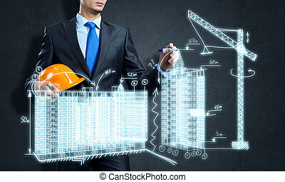 Construction industry - Young man engineer drawing sketches...