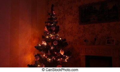 Room decorated for Christmas tree with fireplace
